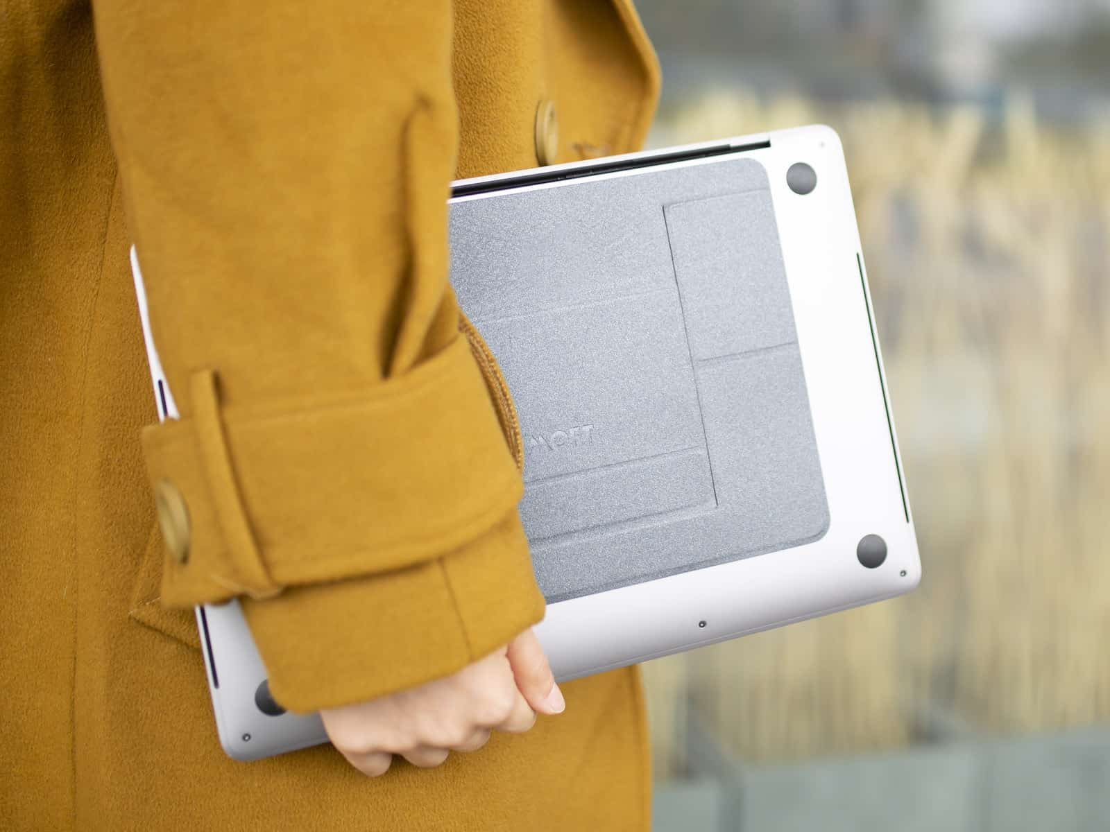 person holding a MOFT laptop stand