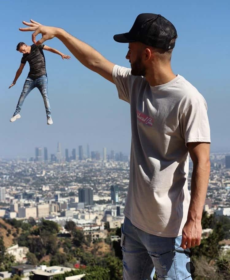 Kleiny dangles an undersized Woody from his fingertips over a city backdrop